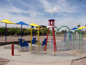 A children's splash park with several spouts spraying water