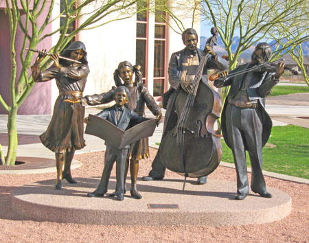 Brass statues of a family band