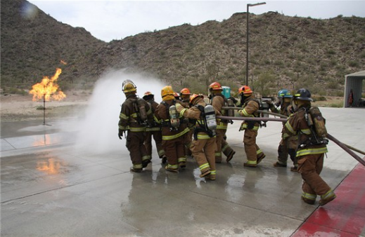 Fire fighters pull hose during training