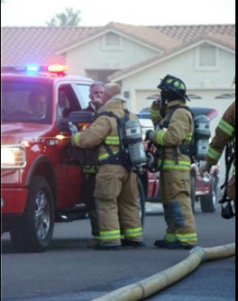 Firefighters converse about an accident